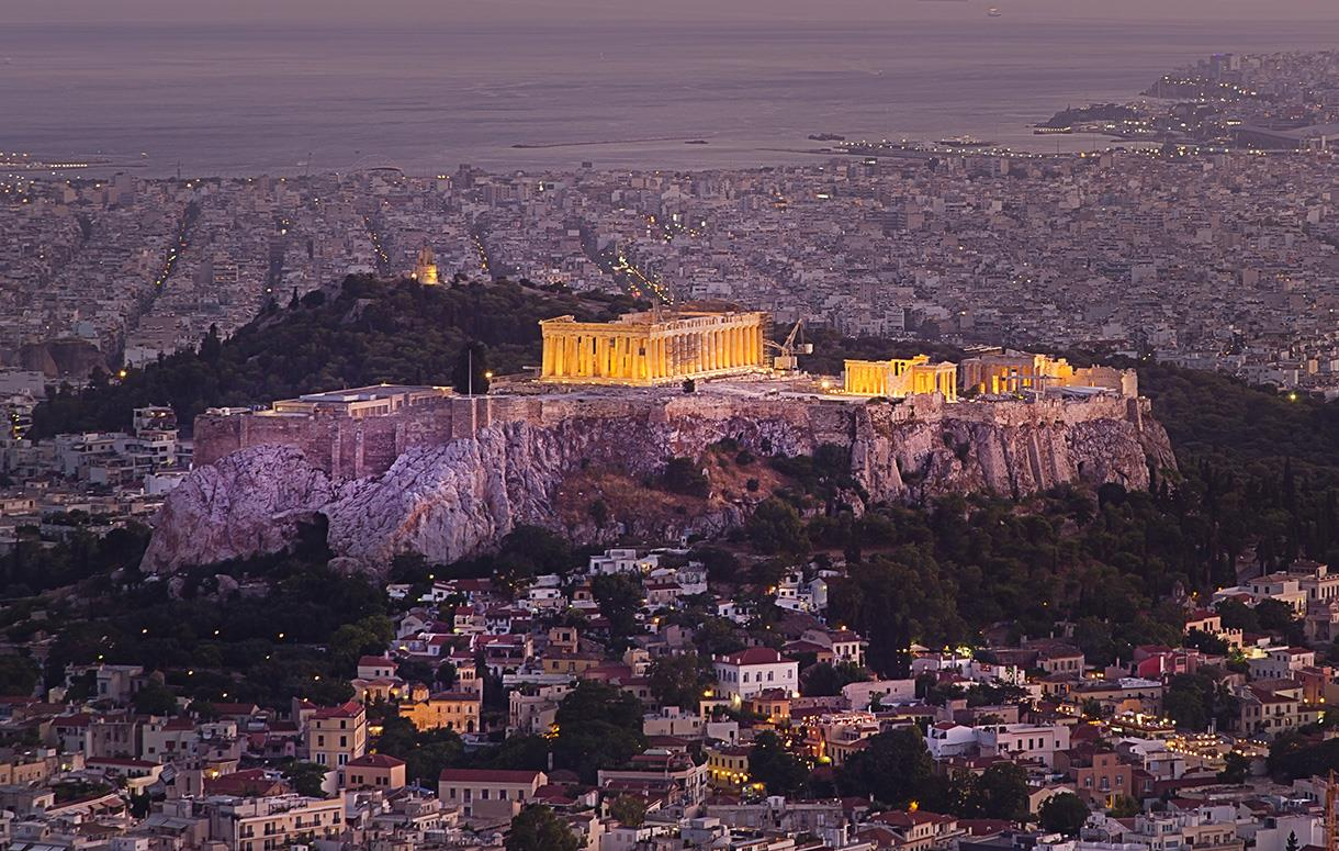 The Acropolis of Athens as seen in the early evening with the city of Athens in the background.