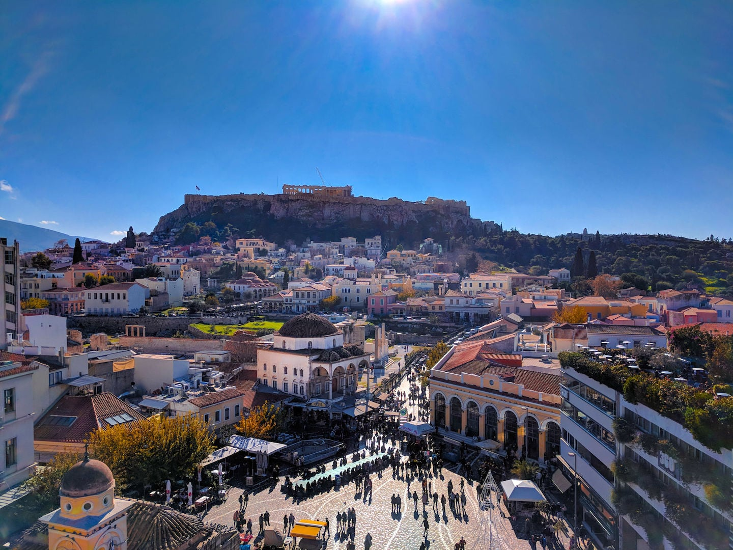 Panoramic view of the Monastiraki square, Plaka, and the Acropolis in Athens, Greece.