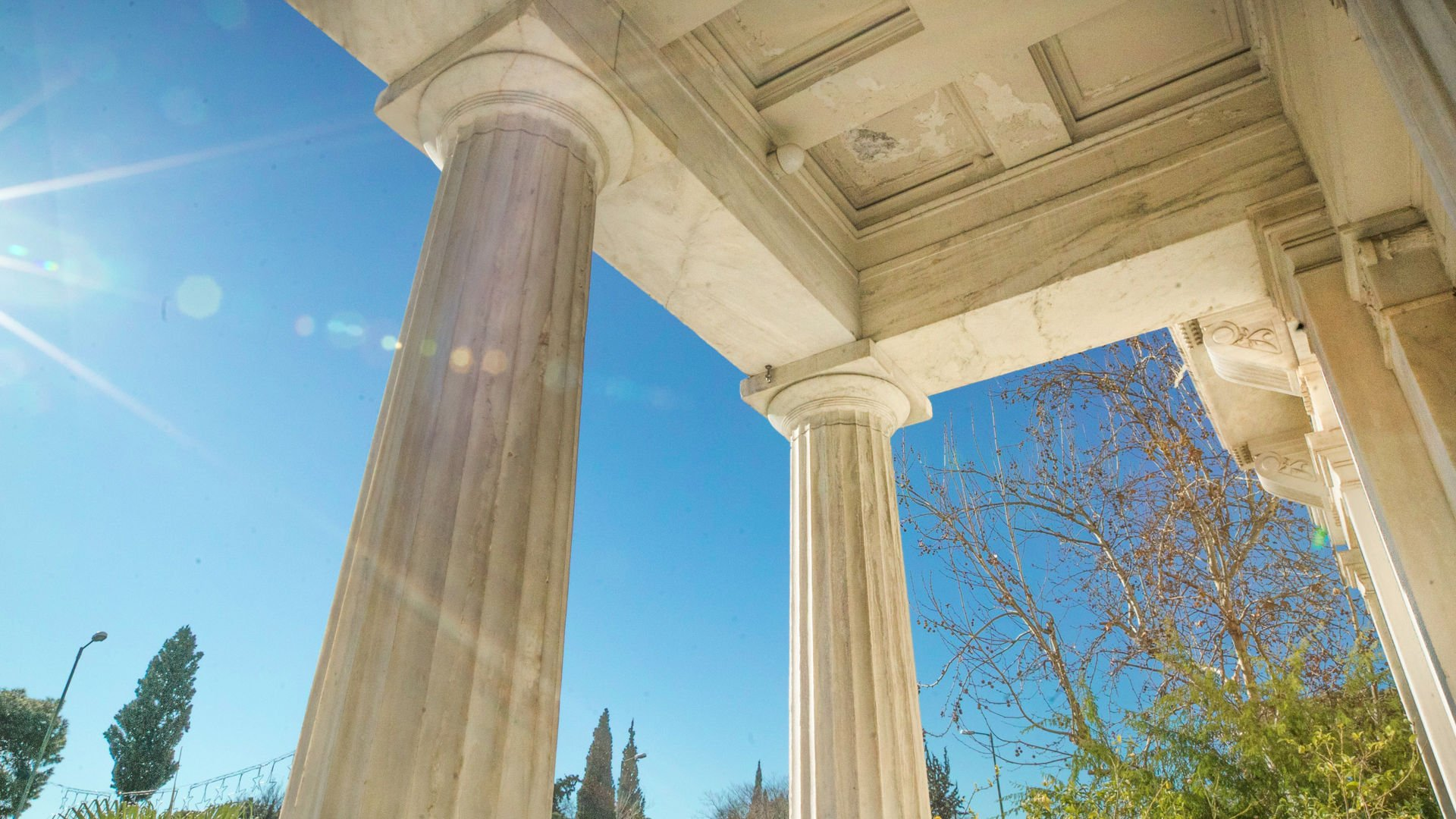 The magnificent columns of the Zappeion Megaron located in the National Gardens of Athens.