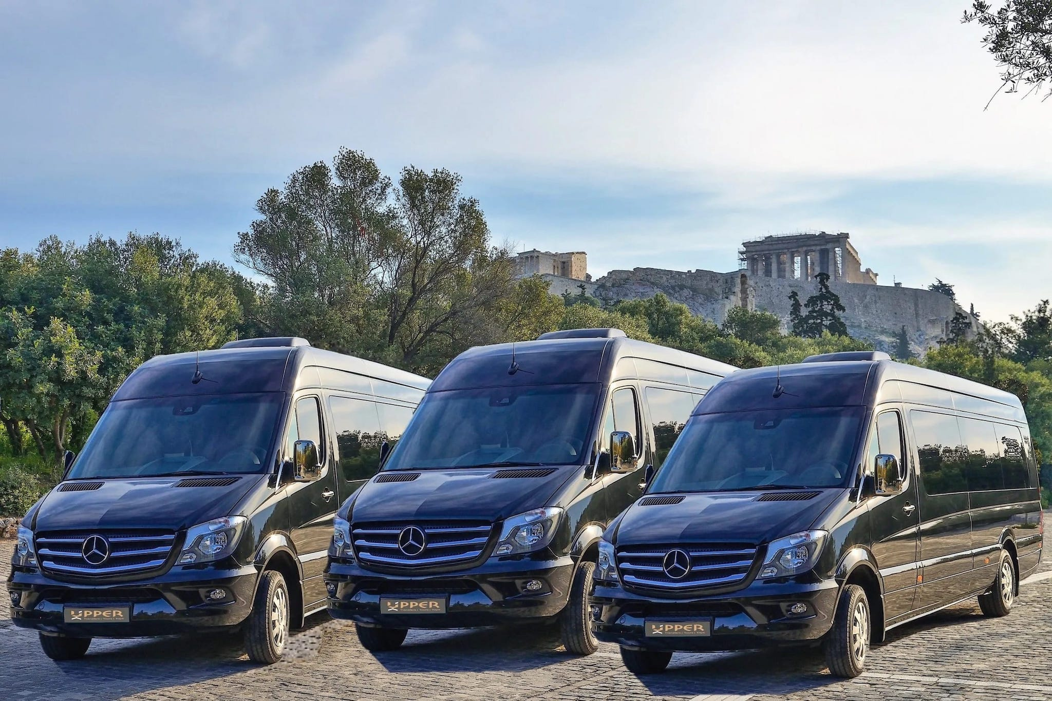 Mercedes Black VIP MiniBuses fleet parkerd under the Parthenon in Acropolis Hill Athens Greece